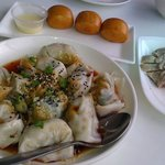 I recommend their poached pork dumplings in chili oil.