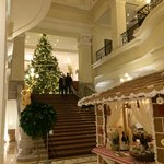 Lobby with gingerbread house and two story Christmas tree