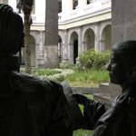 Two bronze statues discuss the view