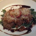 Pan-fried veal scaloppini with  Bolognese sauce, baby spinach  and parmesan cheese