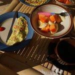 Omelet and fresh fruit for breakfast.