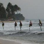 Fischer am Strand lang