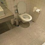 The filthy toilet floor