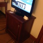 tv stand looks funny because should fit tv comfortably.