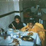 Me as a kid eating at Nam Kee (me on the right)