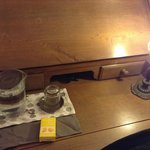 Writing desk with complimentary ear plugs, candy and water