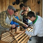 Demonstrating how to make a lobster trap