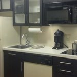 Better view of kitchen area with fridge, sink, dishwasher, coffee maker, range, etc.