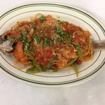 Pescado Entomatada (red fish smother in tomatoes sauce)