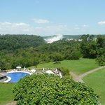 View from balcony to the gardens, pool and the falls