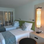 Double beds with view into bathroom