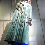 The statute on top of the entrance elevator