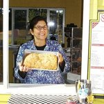Owner Judy holding a freshly baked apple strudel. Sold whole or by the slice.