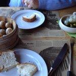 Potatoes, onions, cornichons, and bread fondue accompaniments