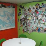 A maps of places people are from in the hostel basement where the kitchen and dining are located
