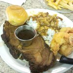 Prime Rib w/ fried shrimp. Served with rice and gravy along with fries.