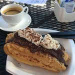 Amazingly fresh eclair and a bold shot of espresso