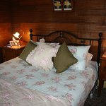 Cosy attic queen bedroom in The Old Bakehouse