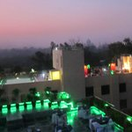 The rooftop restaurant in the foreground (green), then another hotel, then the Taj in the distan