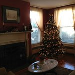 The first floor living area with Christmas tree and fireplace