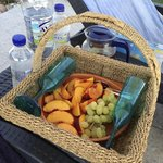 Some fruit and water by the pool