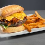 Our Bison Hawaiian burger is served with BBQ pulled pork, topped with pineapple ring and cheese