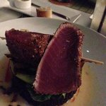 Rare tuna served on black rice with bok choy
