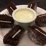 Red Velvet Oreo Cakes - Oreo cookies baked in red velvet cake with sauce anglaise