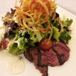 Steak and Greens - grilled 5oz marinated sirloin, vine-ripened tomatoes with peppercorn