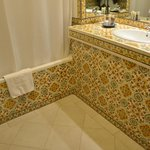 Portuguese tile all throughout the bathroom in the hotel room.