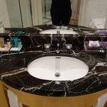 The fancy bathroom vanity with stool.