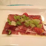 Italian Appetizer - Beef carpaccio and arugula with balsamic vinegar