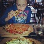 Kevin enjoying the pizza!