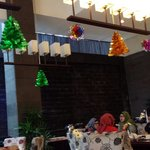 At the restaurant.  Variety of food for breakfast, spacious room & friendly staffs..