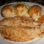 corvina ala plancha and potatoes served hot