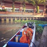 Offer food to monk by the river