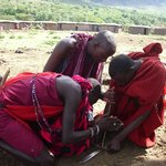 Maasai Tribesmen making fire
