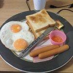 Basic toast, eggs and sausage breakfast.