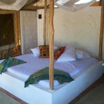 Each room features a permanent, four poster bed in a breezy tent, all en-suite