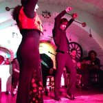 two of the flamenco dancers in action