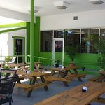 Ample outdoor seating; Downtown Live Oak next to the Courthouse.