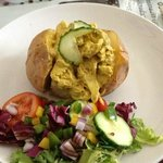 baked potato with filling and salad