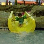 My daughter on one of the kiddie pool water slides.