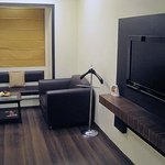 bedroom sitting area and flat screen TV