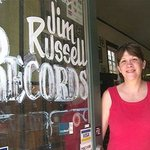 Denise Russell at the door of her store