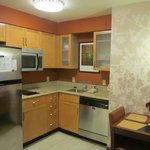 Kitchen has a two element stove top, microwave, dishwasher, & fridge