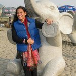 my wife with an elephant statue