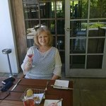 Enjoying sparkling wine outside on the verandah