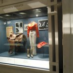 an exhibit of Rodeo and Cowgirl clothing and accessories.
