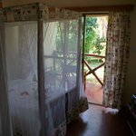 Looking out to the veranda;  orchids on the bed when we arrived !